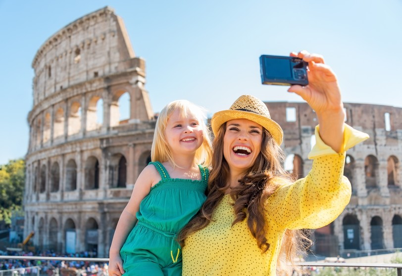Happy mother and baby girl in front of colosseum in rome, Italy shutterstock_253301299.JPG