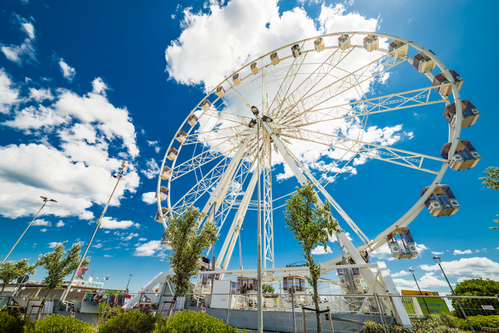 Rimini Ferris wheel over the canal port, in Rimini, Italy shutterstock_432326140.jpg